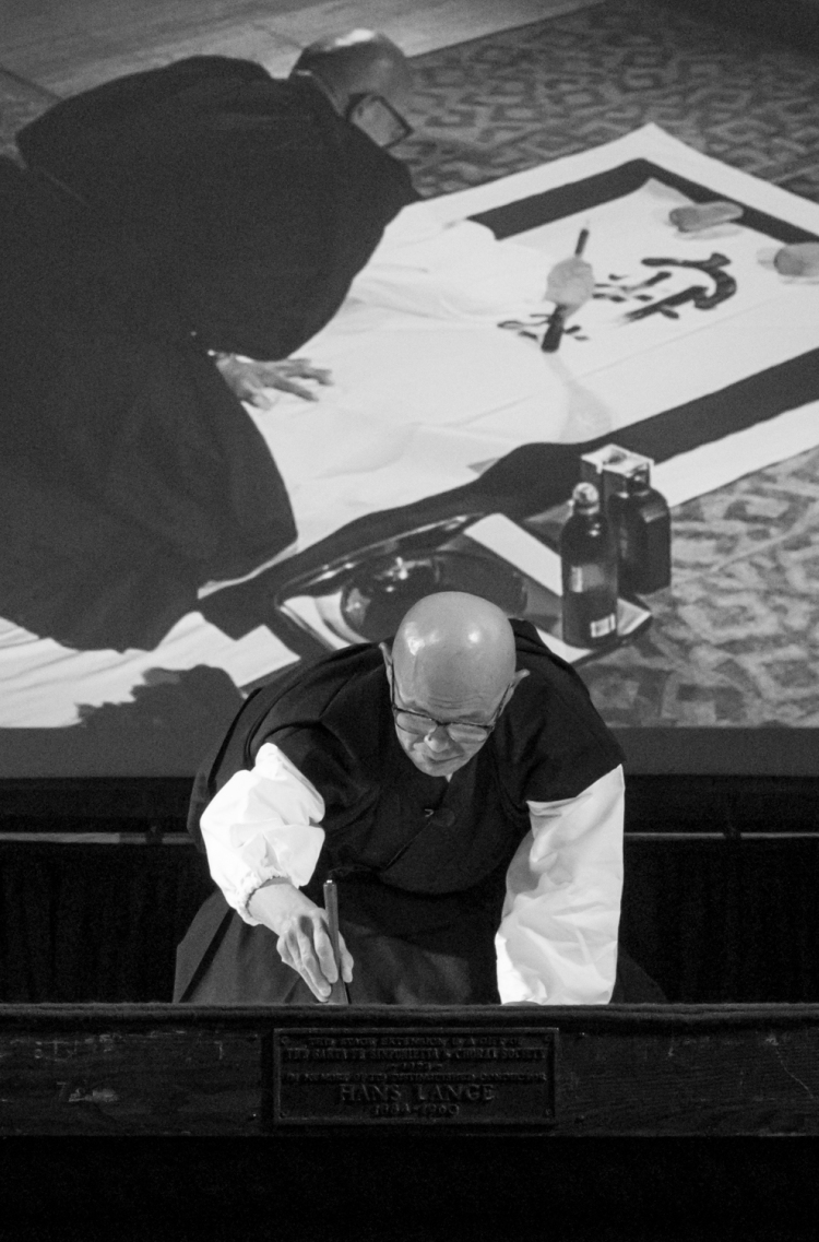 Japanese calligrapher Sodo Harada Roshi paints his first zazen phrase.